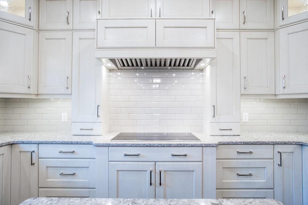 white kitchen cabinets cooktop