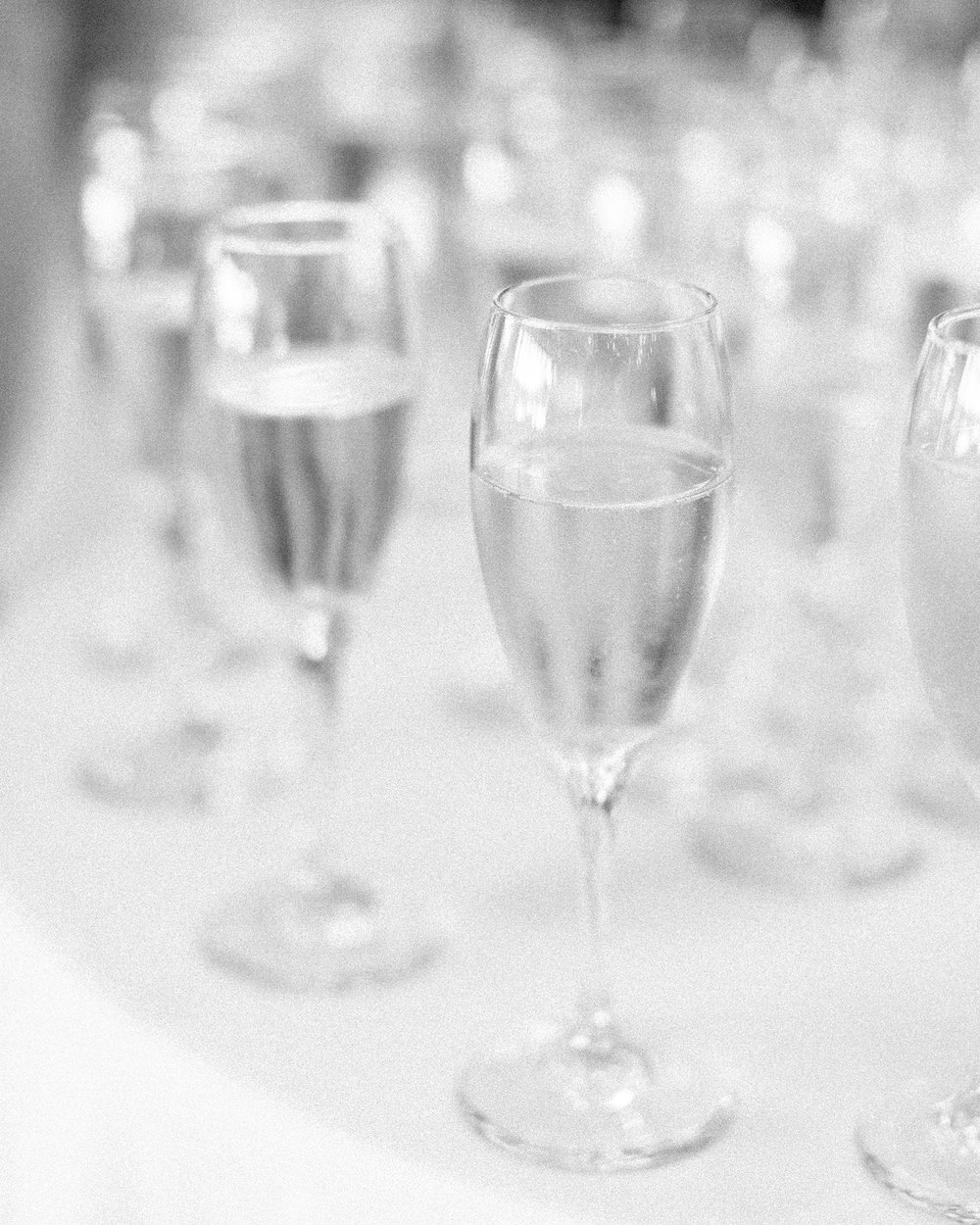 Brandon Sampson Photography. Black and white champagne glasses. Film Photography.