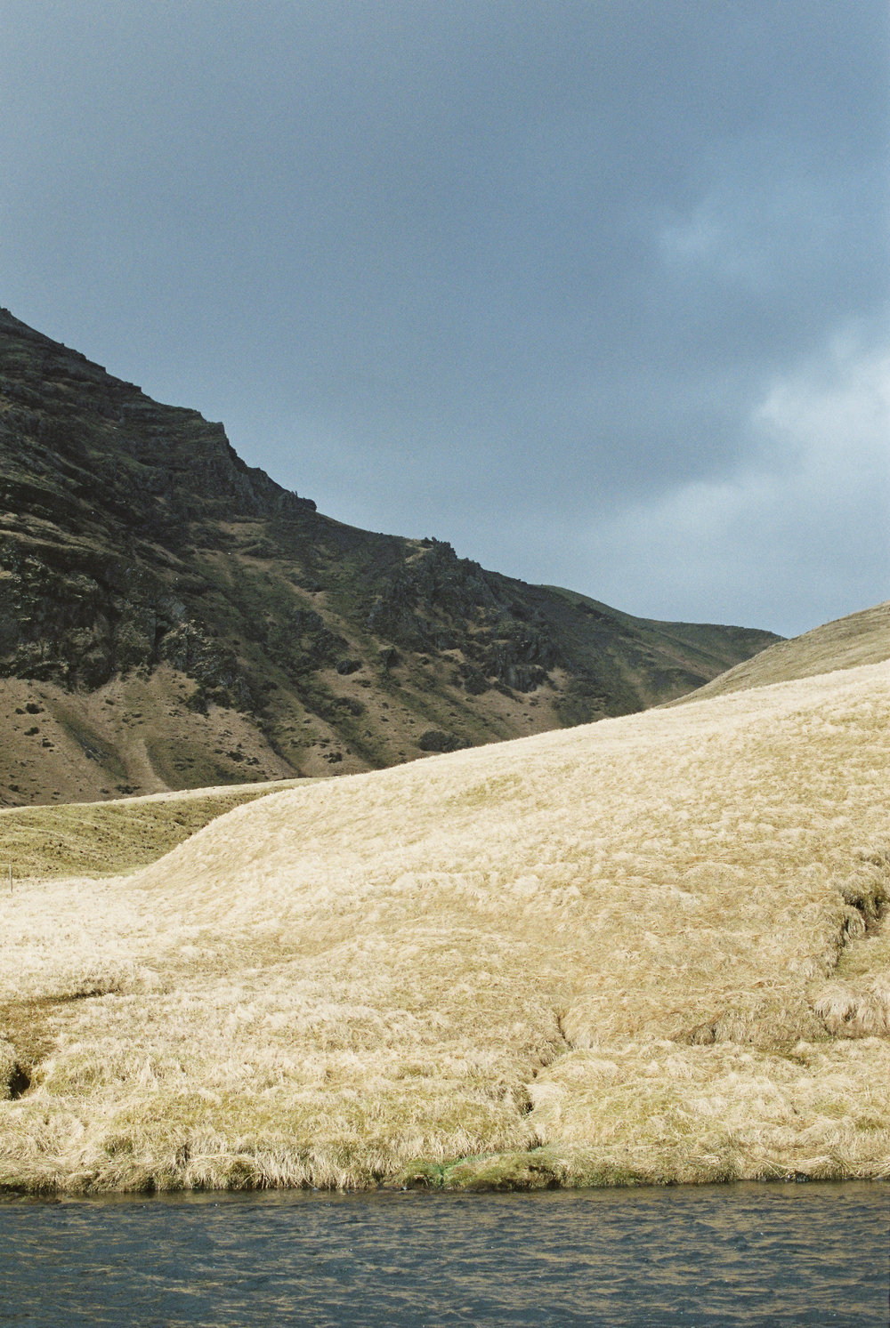 Brandon Sampson Photography. Stormy Hillside Near Skógafoss, Iceland. Film Photography