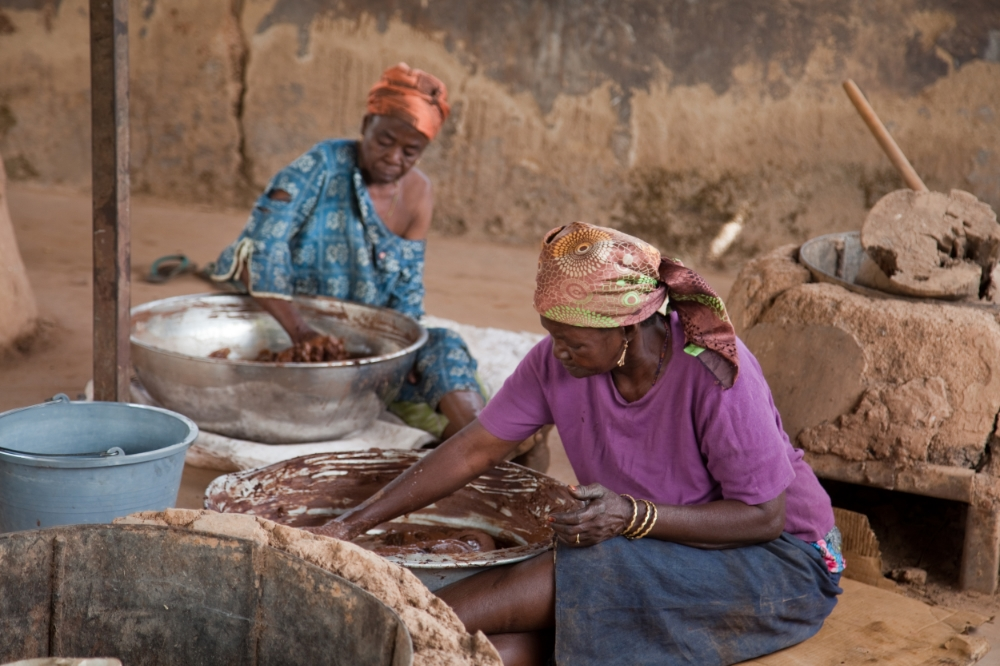 The women of the CMA Shea Butter Cooperative working hard to produce their shea butter.
