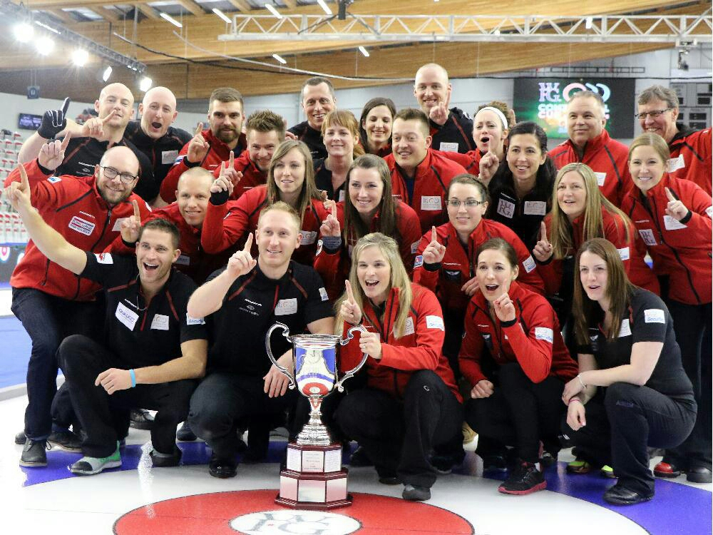 Team Canada celebrates with the Continental Cup at the Markin McPhail Centre in Calgary on Sunday. Gavin Young / Calgary Herald