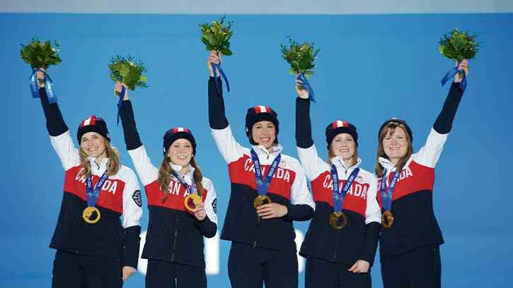 Submitted Photo Jennifer Jones, Kaitlyn Lawes, Jill Officer, Dawn McEwen and Kirsten Wall with their gold medals in Sochi.