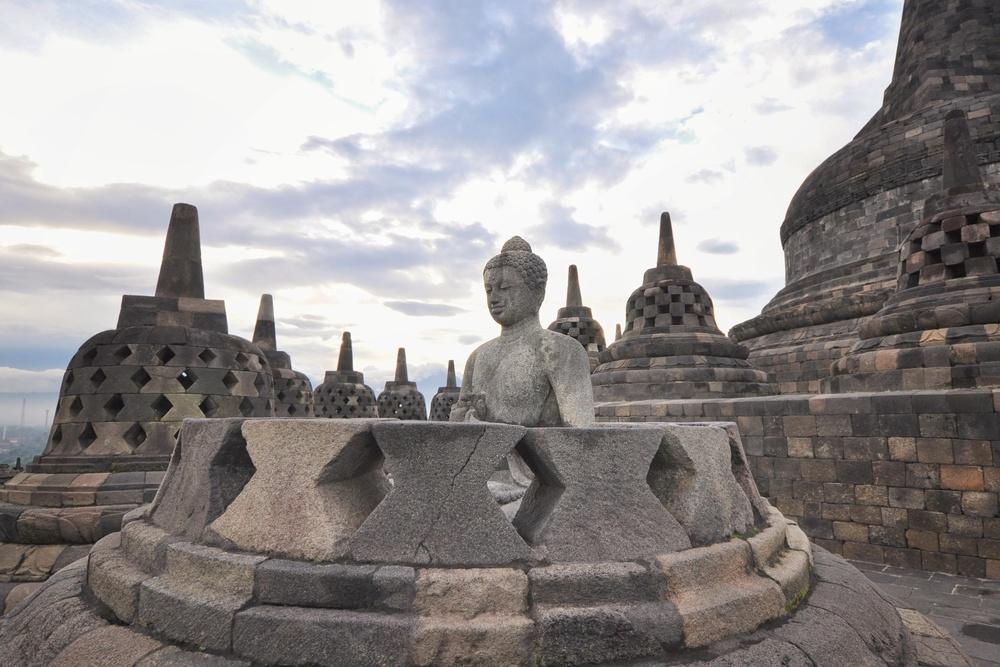 An open stupa at Borobudur temple, Indonesia | www.idrawletters.com