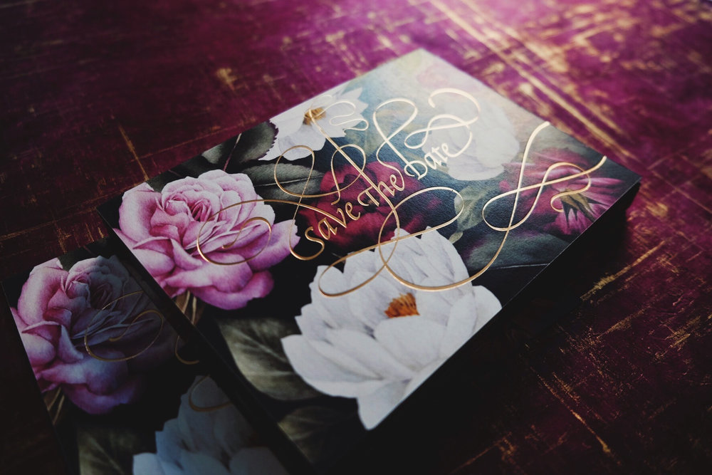 Calligraphy in gold foil on a watercolor florals for a luxury custom wedding invitation by Chavelli | www.chavelli.com