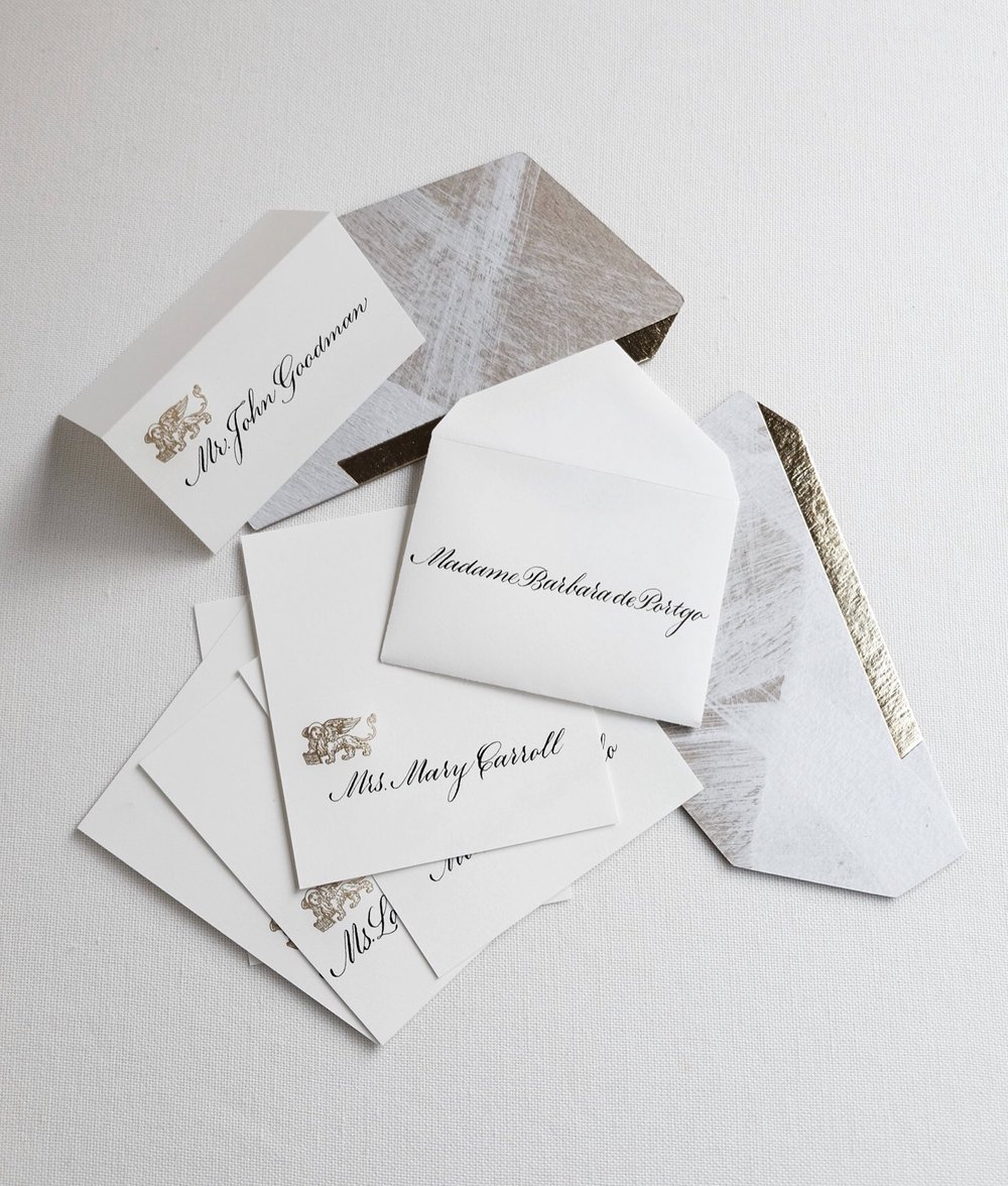 Elegant copperplate script calligraphy place cards and escort envelopes // by Chavelli www.chavelli.com