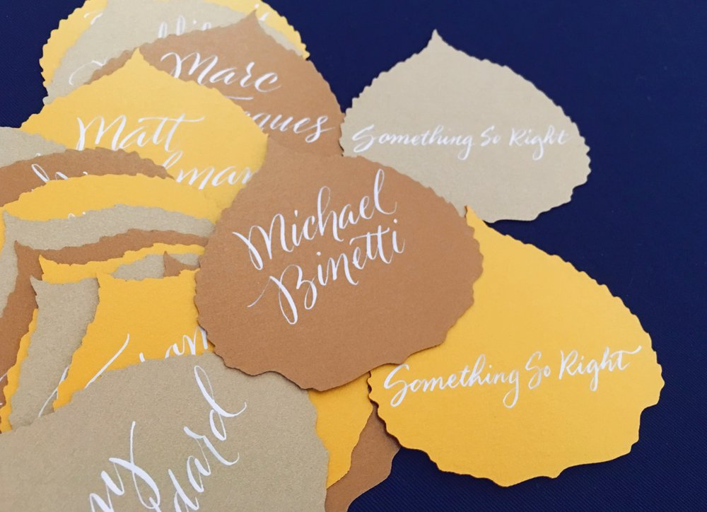 Custom laser-cut aspen leaves with quirky script calligraphy for special escort cards // by Chavelli www.chavelli.com