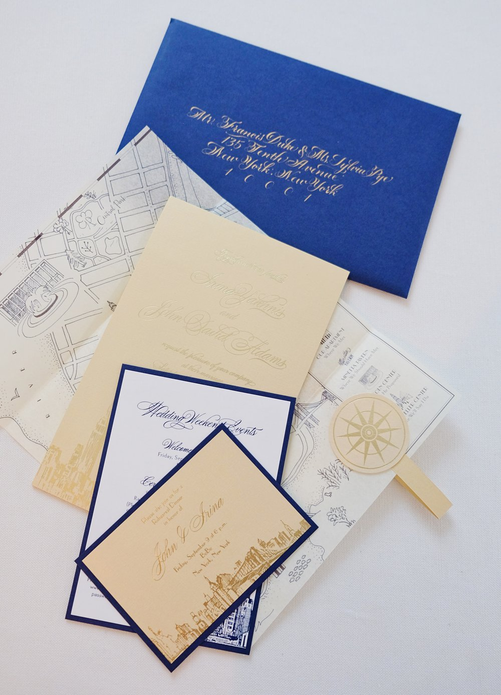 Custom wedding invitation suite with custom illustrated map, hand-drawn NYC sketches, embossing and calligraphy for the envelope addressing // by Chavelli www.chavelli.com