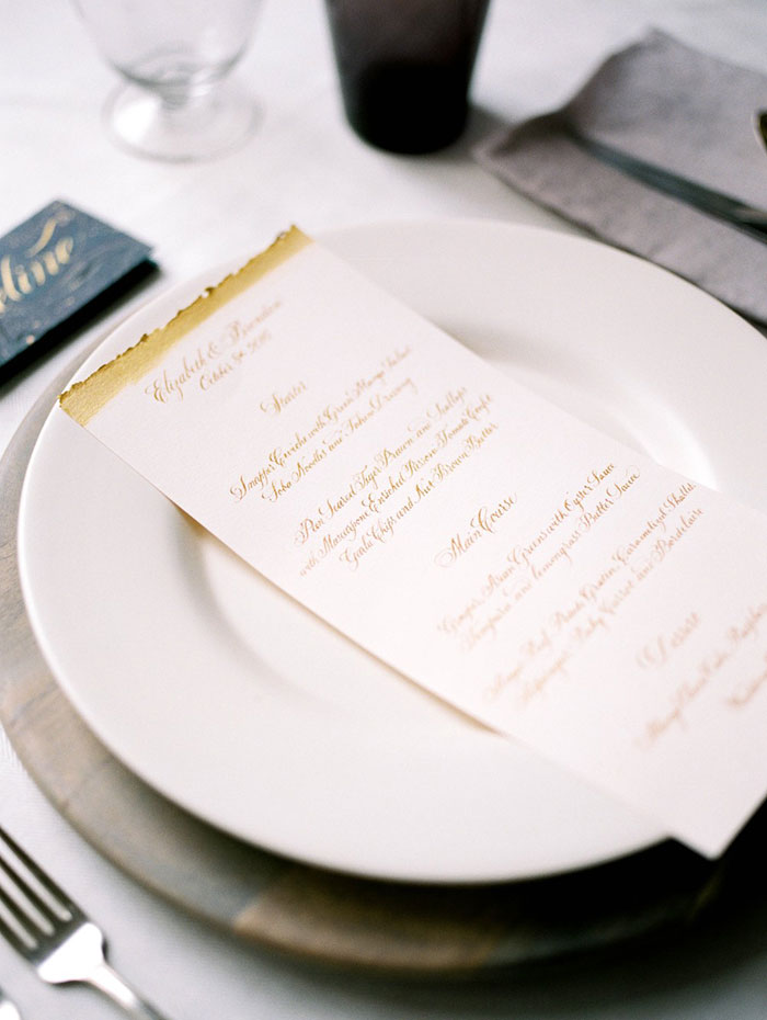 Calligraphy wedding menu with deckled gold edge // by Chavelli www.chavelli.com // photo by Jessica Rieke www.jleephotos.com