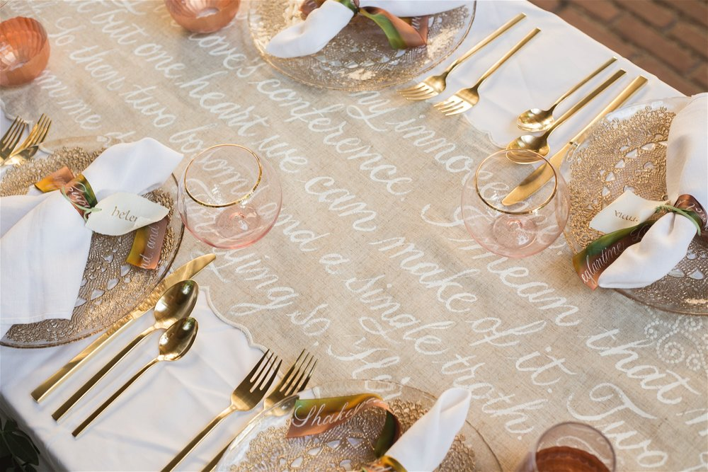 Brush painted calligraphy on a table runner, with Carolingian calligraphy place cards and brush lettered  silk ribbon for an elegant tablescape // by Chavelli www.chavelli.com