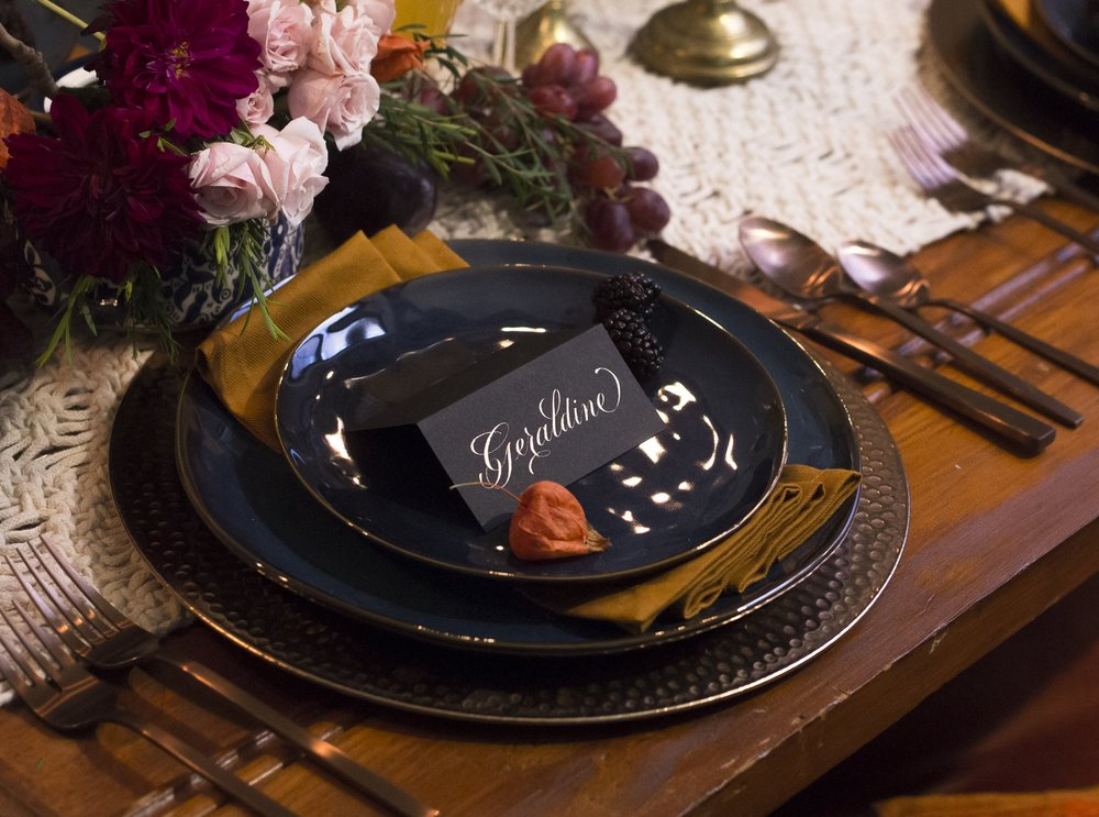 Rose gold calligraphy on black paper for a deep and lush Thanksgiving table // Calligraphy by Chavelli www.chavelli.com // photo by Rebecca Jeanson www.rjimagery.com