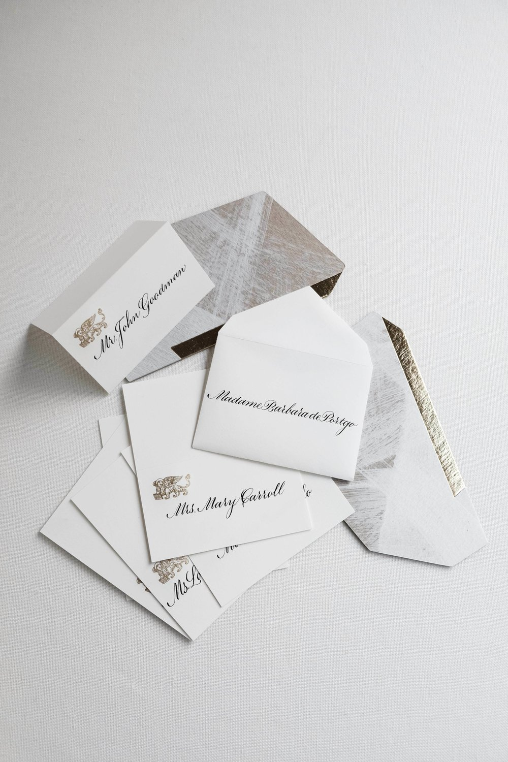 Classic envelope escort cards and tented place cards // Calligraphy by www.chavelli.com
