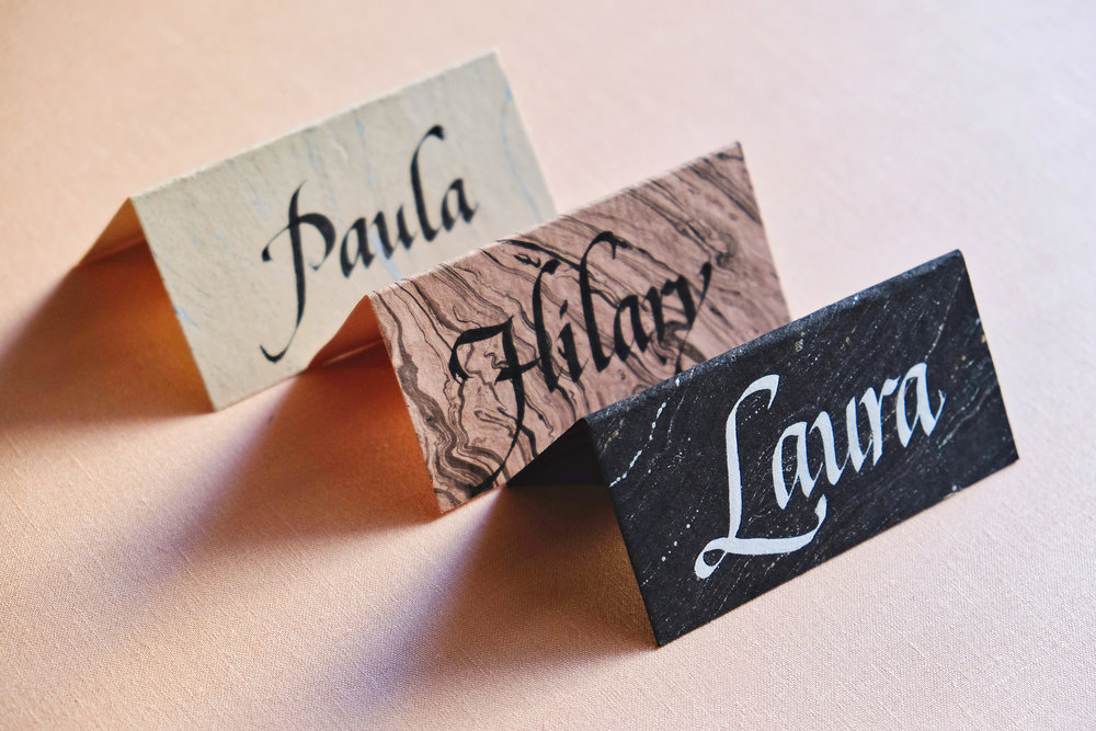 Classic italic calligraphy on marbled place cards // design and calligraphy by Chavelli www.chavelli.com