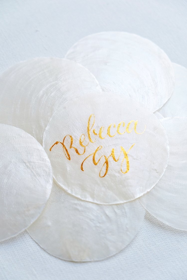 Capiz Shell place cards with calligraphy // by Studio Chavelli www.chavelli.com