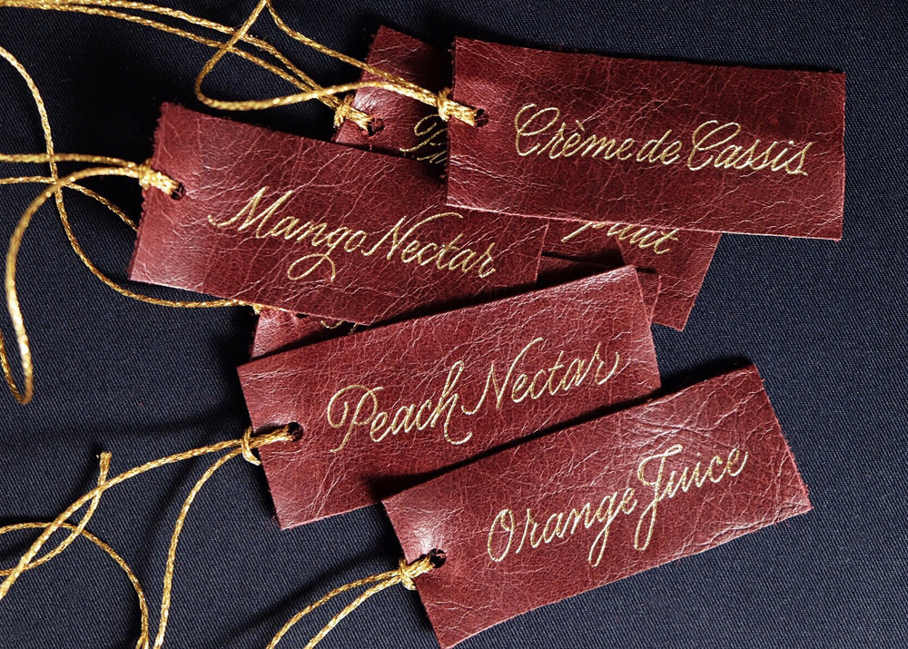 Hand-made leather drink tags with gold foil // design and calligraphy by Chavelli www.chavelli