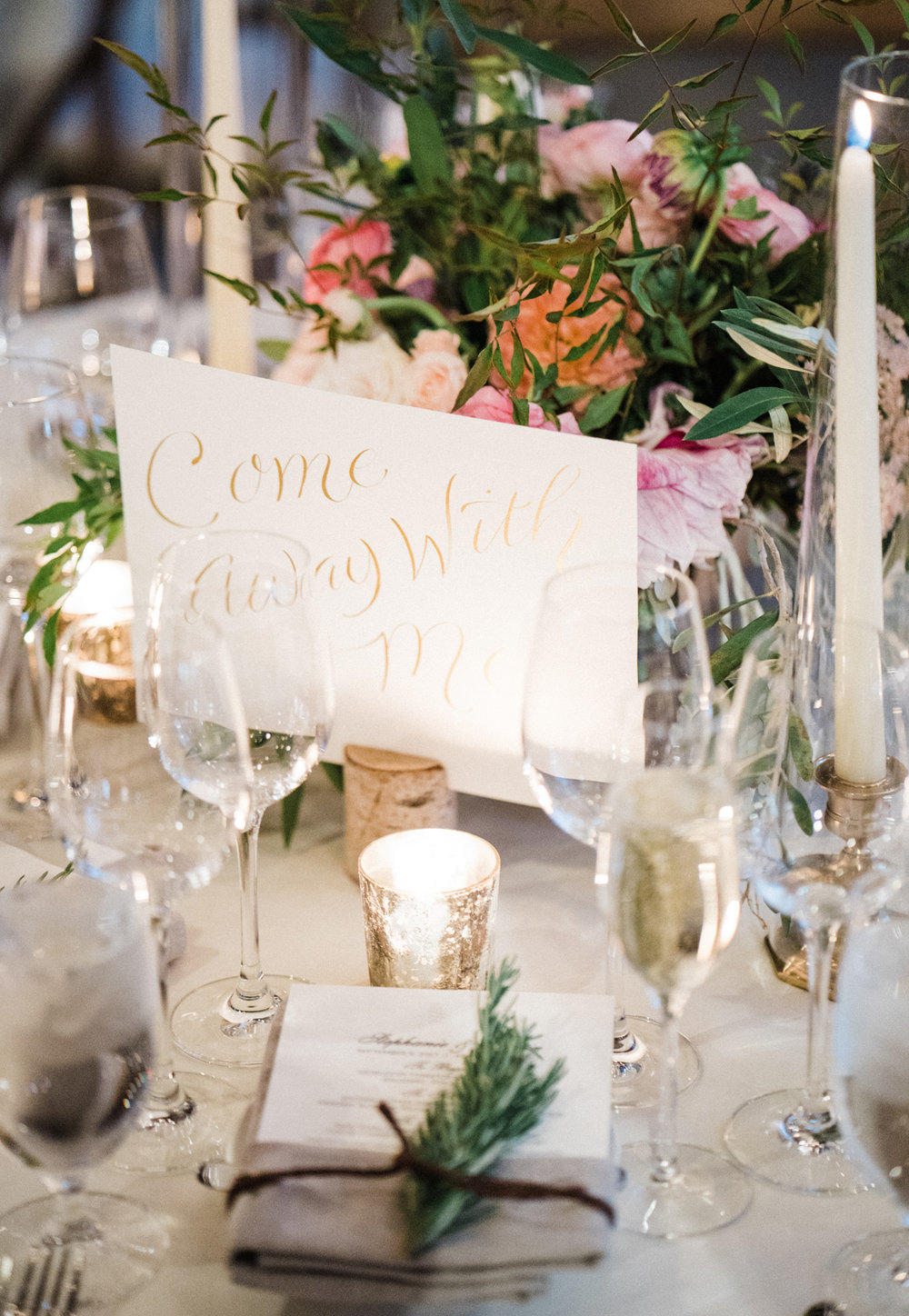 Song titles as table numbers, handwritten in calligraphy   www.chavelli.com