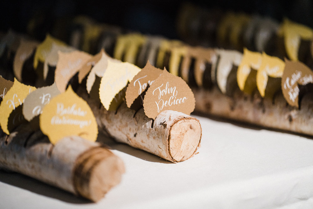 Die-cut aspen leaf escort cards with calligraphy   www.chavelli.com