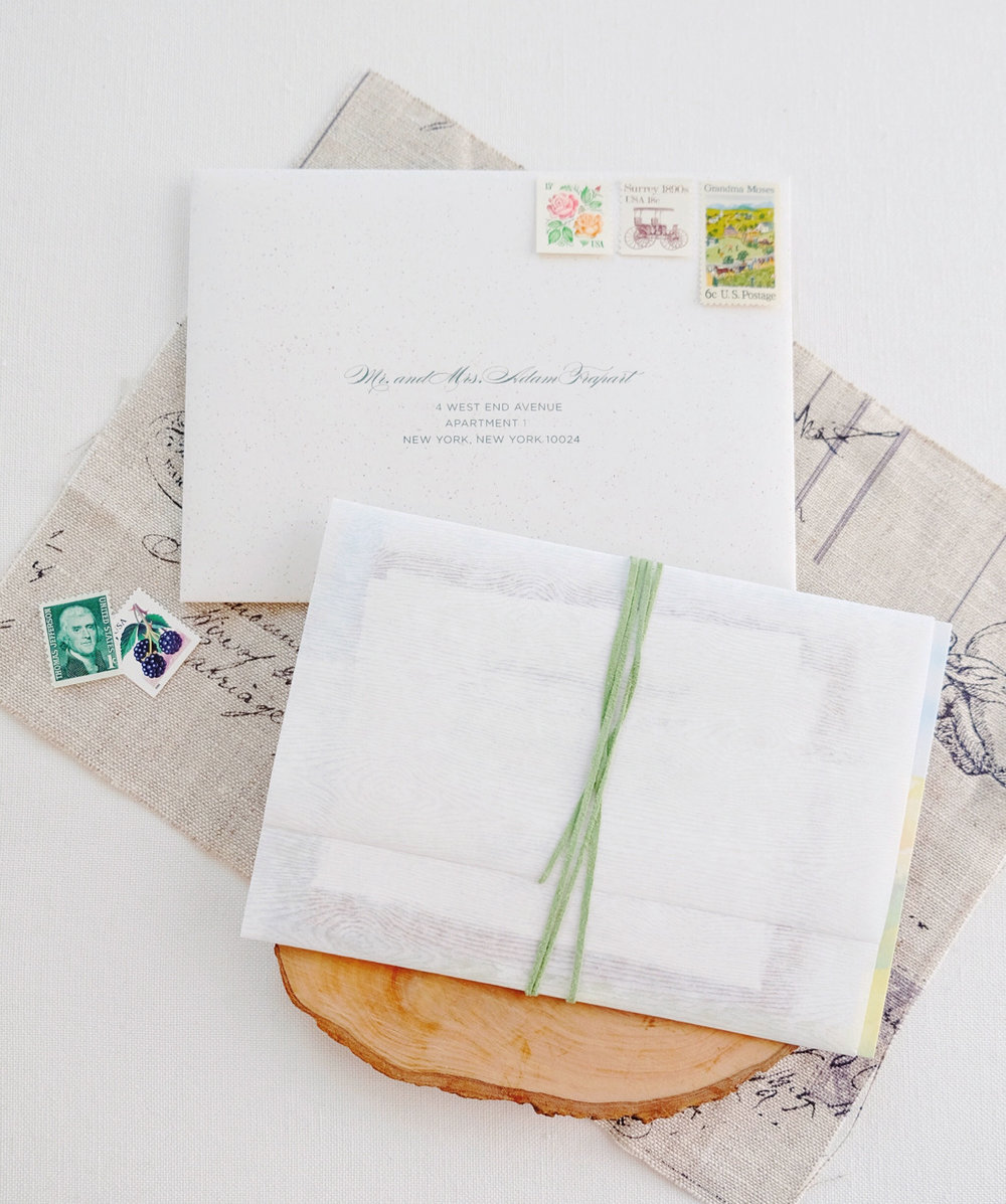 The layered invitation and inserts were enclosed in a wood grain embossed translucent wrap, secured with a green suede ribbon   www.chavelli.com