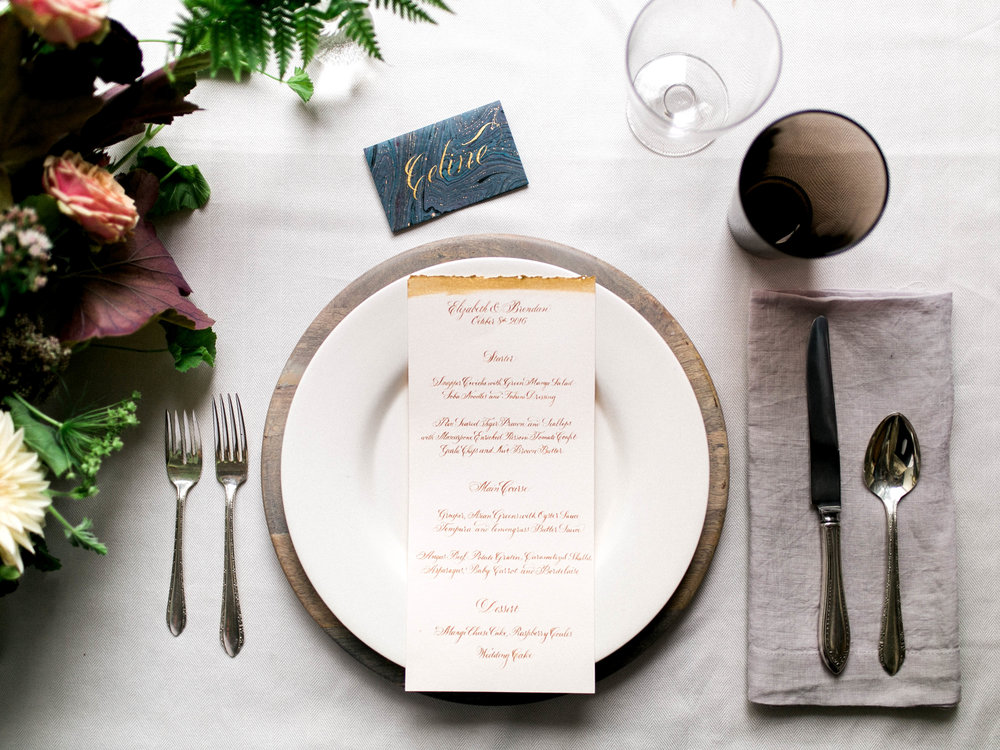 Wedding menu in gold calligraphy with a deckled edge | www.chavelli.com