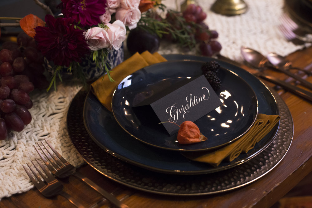 Copper script calligraphy on black place cards | by Chavelli www.chavelli.com