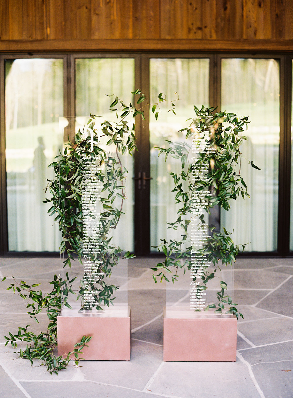 Blackberry Farm Wedding: acrylic guest seating chart with greenery   designed by Chavelli www.chavelli.com
