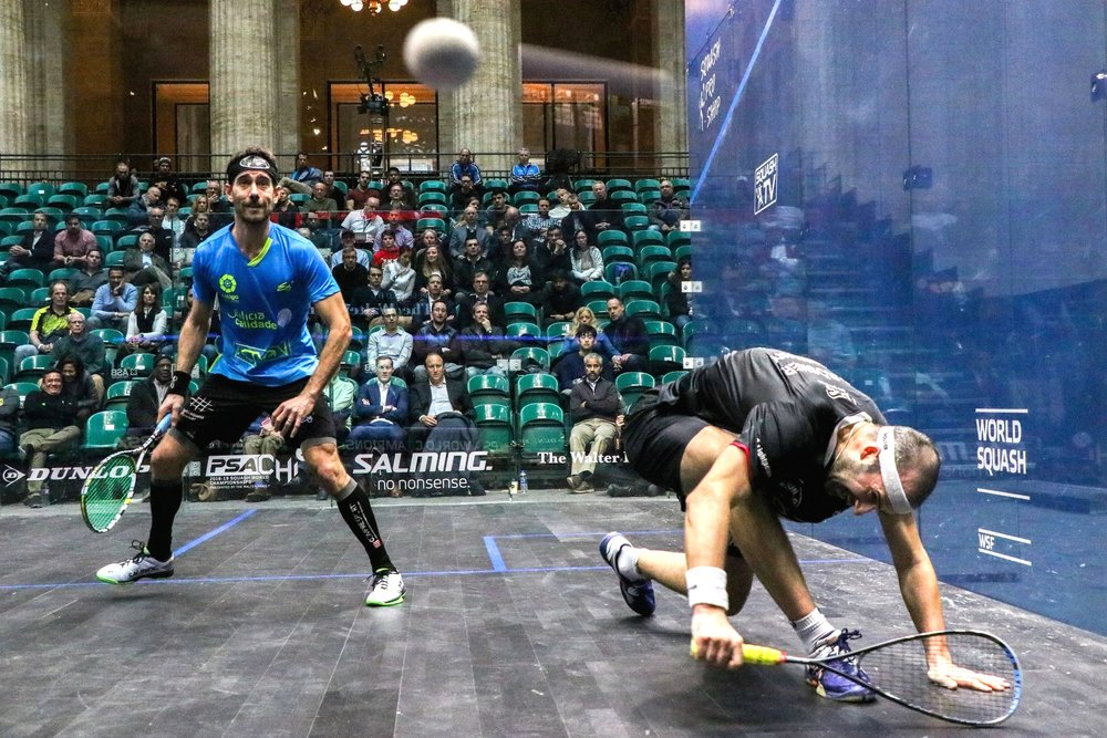 Borja Golan keeps his eye on the ball as Simon Rosner recovers from a dive. Golan of Spain lost to Rosner of Germany 2:3 in the third round of the Pro Squash World Championships.