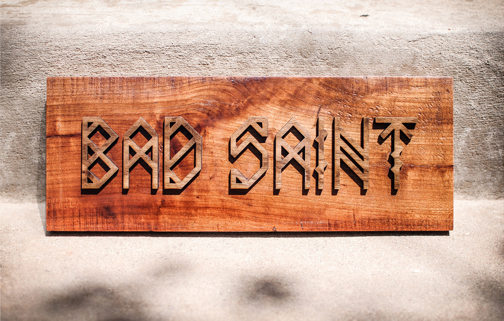 Laser cut walnut and reclaimed cherry wood sign for Washington, D.C. based restaurant, Bad Saint.