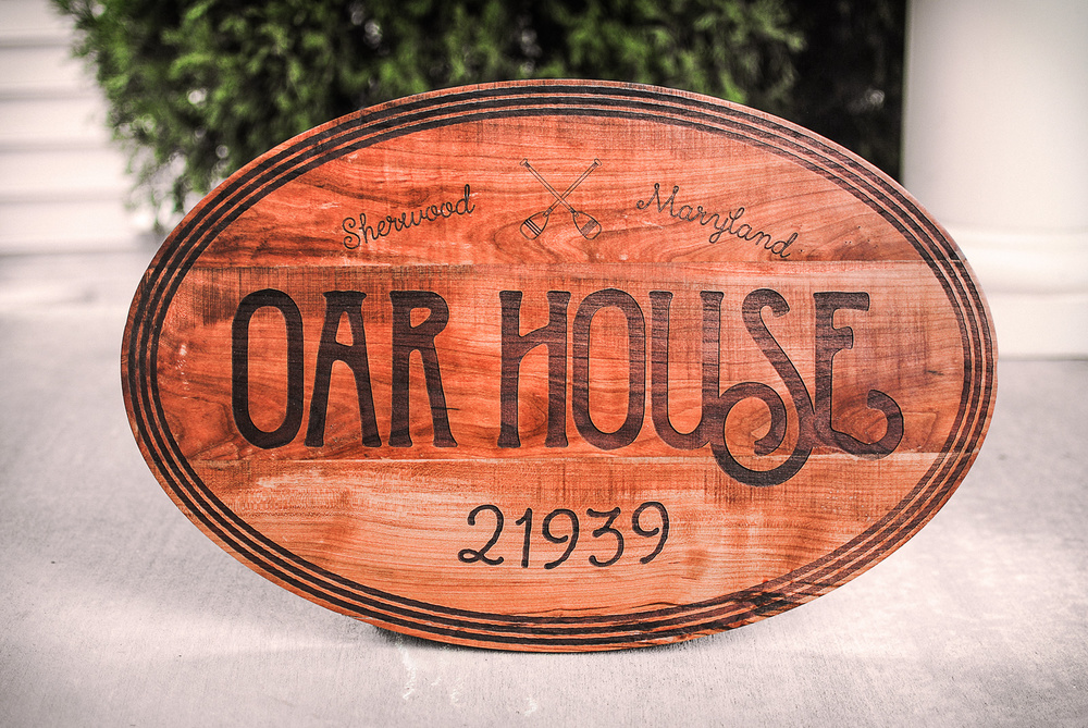 A laser engraved and lasercut house number sign made out of reclaimed cherry.