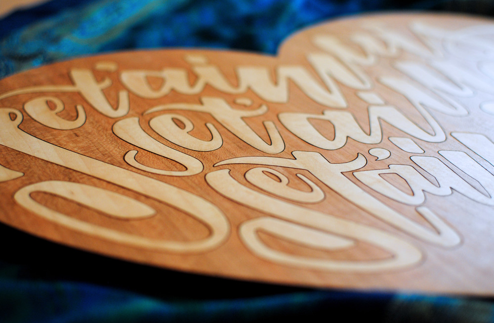 Laser cut art piece. Maple marquetry inlay into cherry wood.