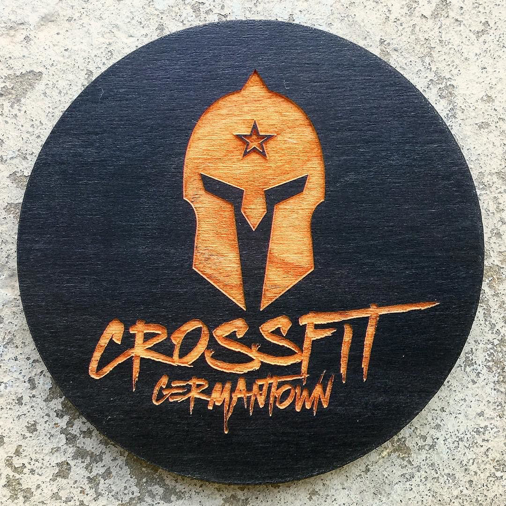 Jet black and laser engraved coasters for Crossfit Germantown