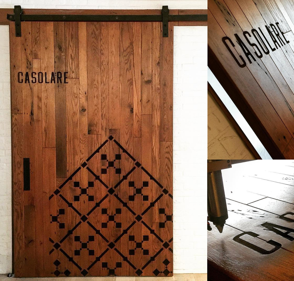 Laser engraved, reclaimed wood barn door for Maryland-based Casolare restaurant