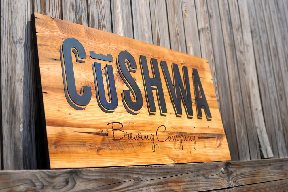 Our first sign on the new laser: a 4-foot-wide beauty created for Cushwa Brewing Company. It's made of reclaimed pine and inlaid steel.