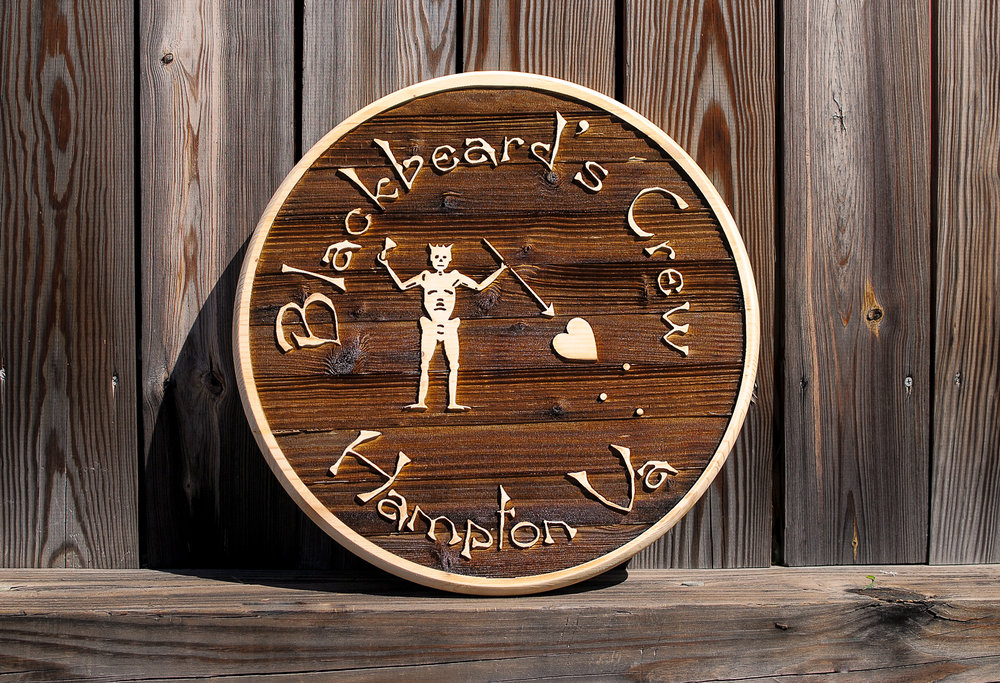 Pirate sign, laser engraved on pine.