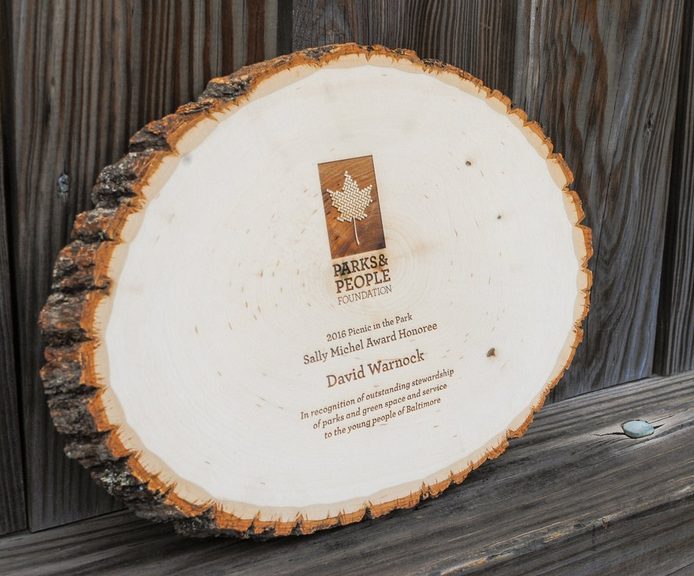 Rustic, laser engraved award on a birch round