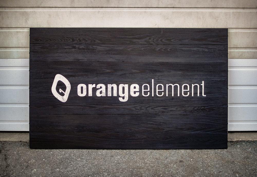 Sign for Baltimore Maryland based design agency, Orange Element. Utilizing Shou Sugi Ban (Japanese wood burning). Laser cut steel letters inlaid into laser engraved cypress.