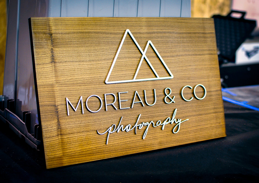 Laser cut and engraved photographer sign. Birch on walnut.