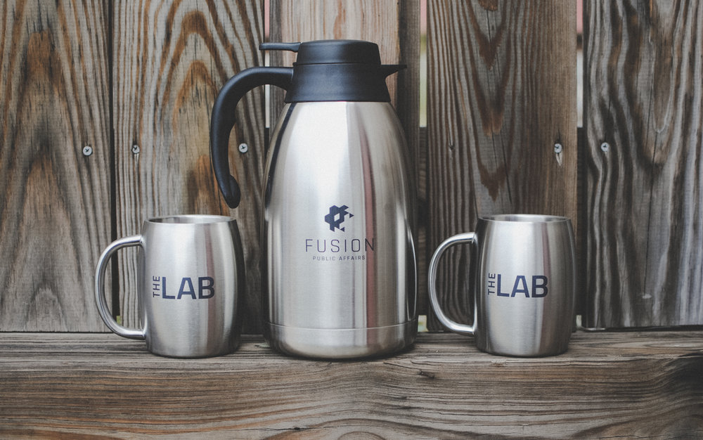 Laser etches stainless mugs and coffee pot for a Washington, D.C. based design firm.