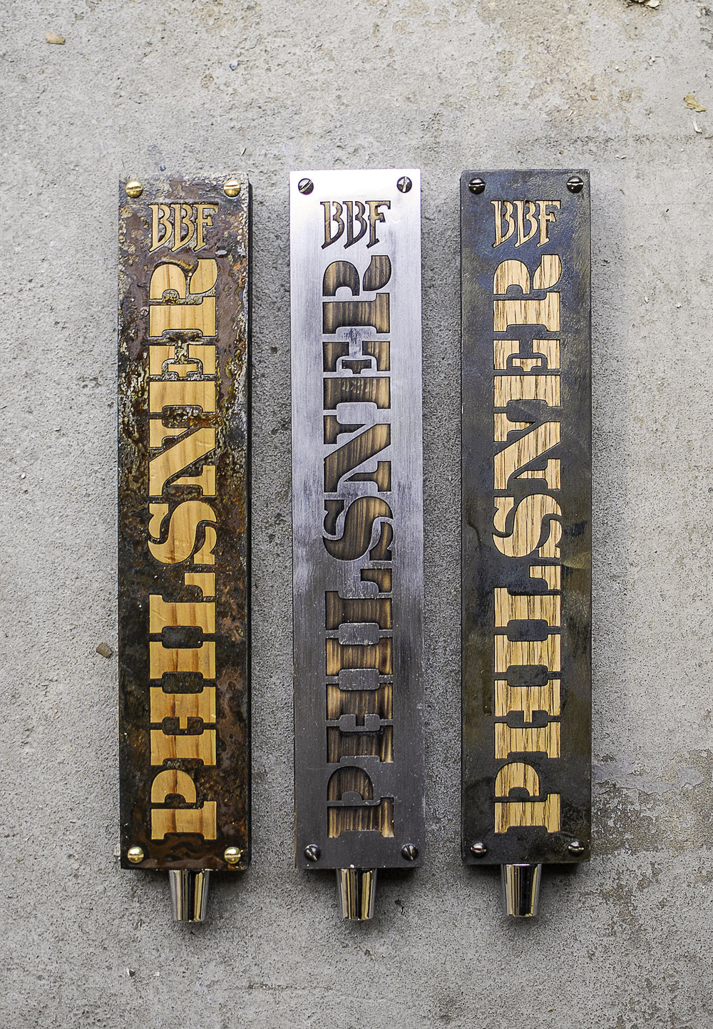 Reclaimed wood and steel tap handles for Maryland-based brewery, Brookville Beer Farm. Uses a variety of hardwoods and chemicals to alter the appearance of the steel.
