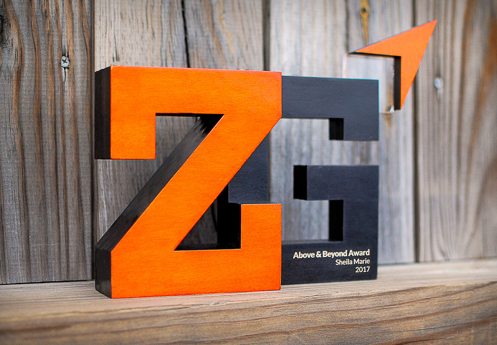 Custom designed award for ZwillGen. Laser cut out of maple hardwood and acrylic