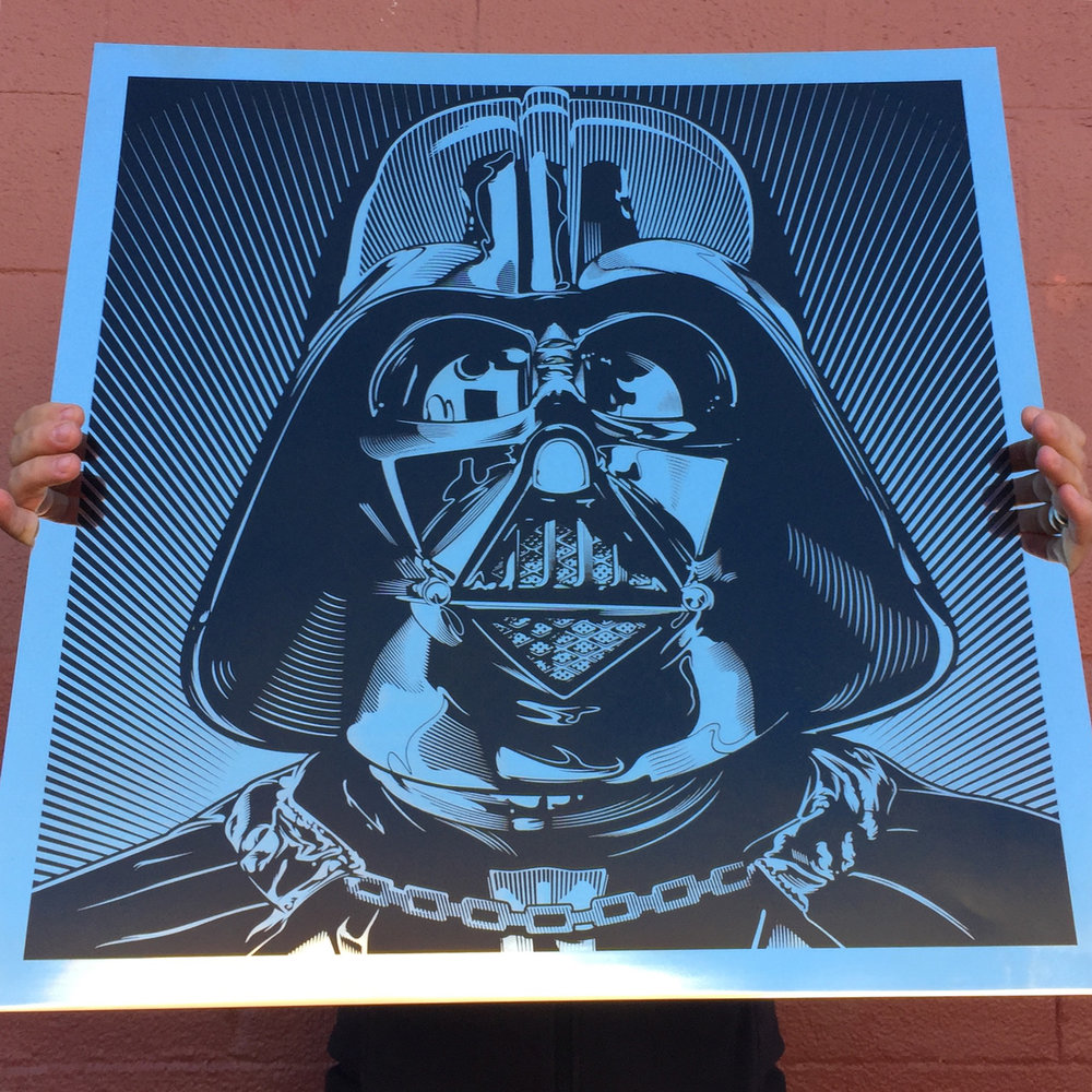 A massive laser etched Darth Vader on mirror finish stainless steel.