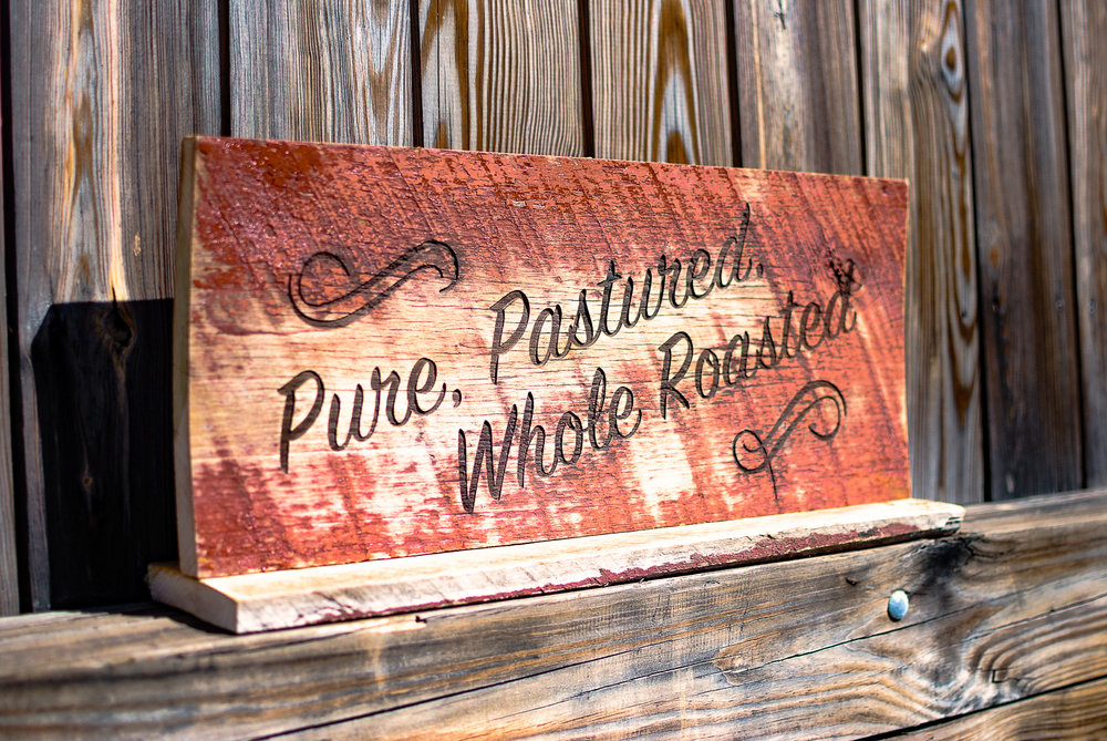 A free standing, reclaimed barn wood siding sign for Marriott.