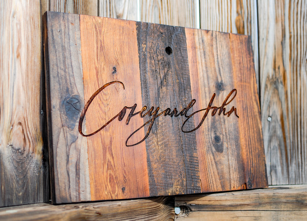 A laser engraved and laser cut wedding sign made of reclaimed redwood.