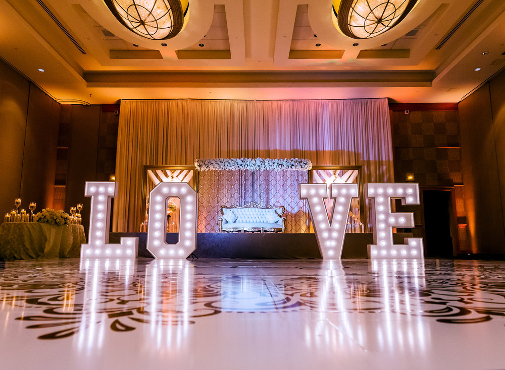 5 foot tall white marquee style letters with carnival lights.