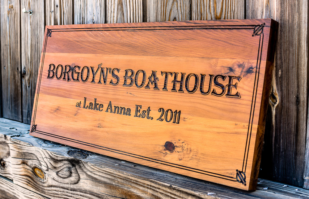 Laser engraved and laser cut boat house sign made of reclaimed redwood