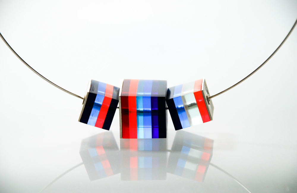 One large & two small Cube Necklace.  Silver & Plexiglas pendant on silver choker. €180