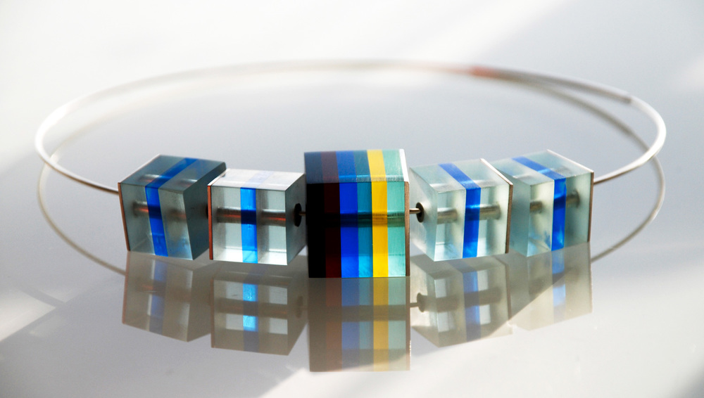 One large & four small Cube Necklace.  Silver & Plexiglas pendant on silver choker. €200