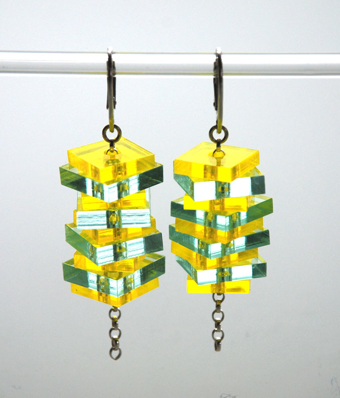 Large drop earrings . Plexiglas 13&15mm squares on silver belcher chain.  €60