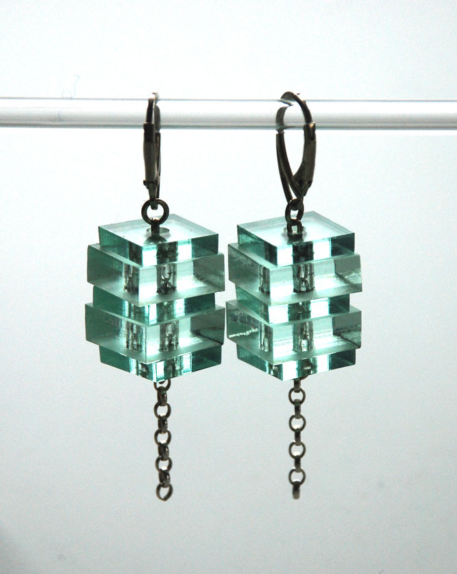 Medium drop earrings.    Plexiglas squares on silver belcher chain.   €50