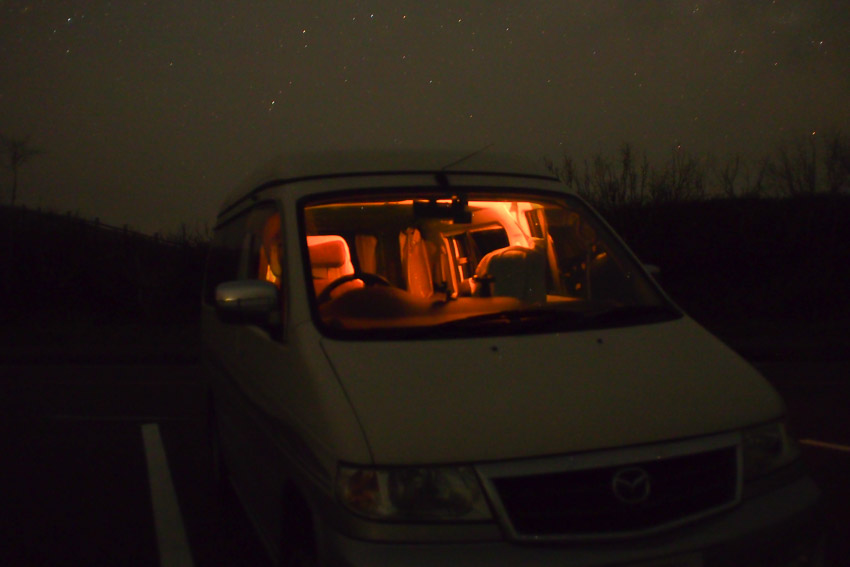 Mazda Bongo hired from  Japan Campers , parked in the carpark. Martina sleeping inside.