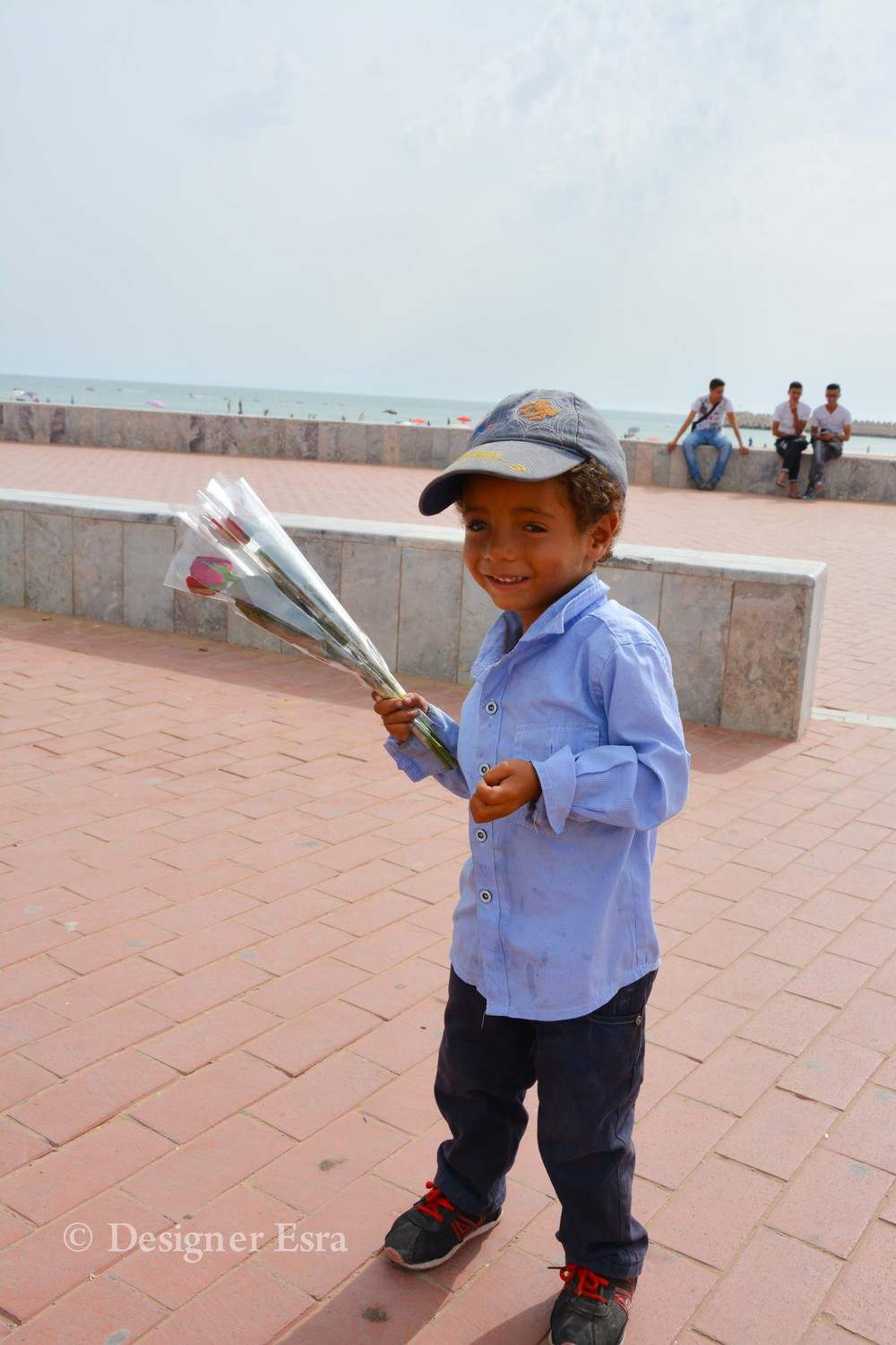 The cutest & youngest flower seller in Agadir, Morocco