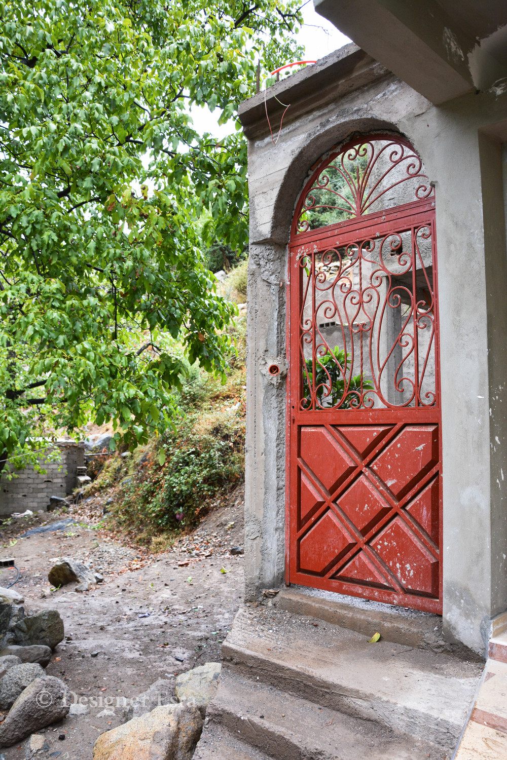 Bright Red Door in the mountains